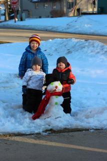 boys and snowman